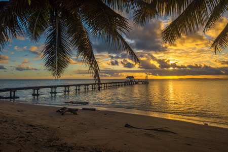 Pier on a tropical island, holiday landscape photo