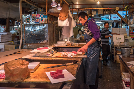 biggest: TOKYO, JAPAN - November, 22, 2014: Tuna sellers at Tsukiji, the biggest fish and seafood market in the world.