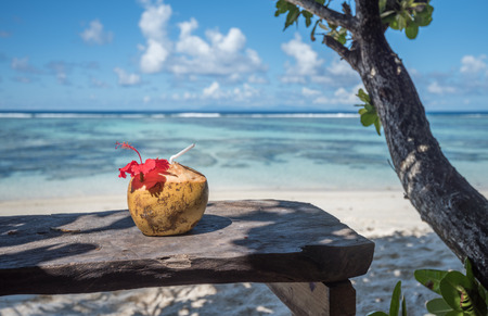 pina: Pina colada in coconut on the tropical beach, Seychelles Stock Photo