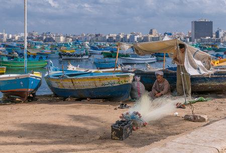 fisherman boat: ALEXANDRIA, EGYPT - September, 30, 2008: Egyptian fishermen in Alexandria harbour Editorial