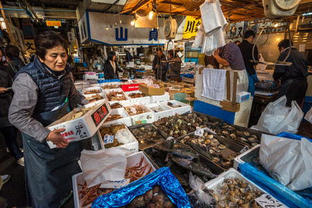 biggest: TOKYO, JAPAN - November, 22, 2014: Seafood sellers at Tsukiji, the biggest fish and seafood market in the world.