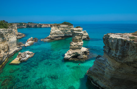 italy background: Rocky beach in Puglia, Torre Sant'Andrea, Italy Stock Photo