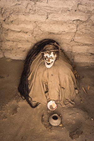 mummification: Chauchilla Cemetery with prehispanic mummies in Nazca desert, Peru