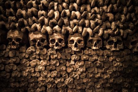grave: Skulls and bones in Paris Catacombs Stock Photo