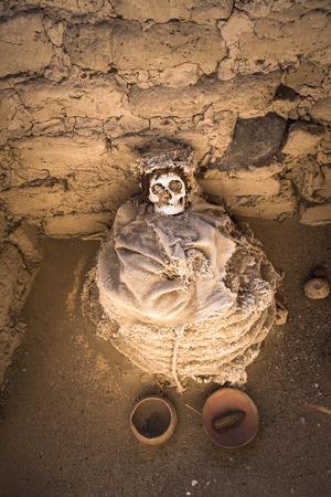 mummification: Chauchilla Cemetery with prehispanic mummies in Nazca desert, Peru