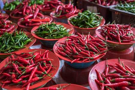 spice market: Colorful chilli peppers stall, asian market
