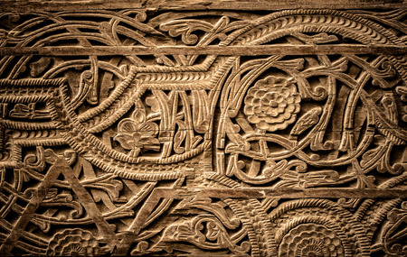 Close-up image of ancient doors with oriental ornaments from Uzbekistan & Wood Carving Door Stock Photos. Royalty Free Business Images