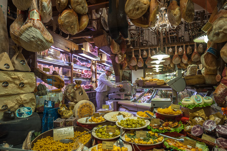 BOLOGNA, ITALY - March 8, 2014: Window of typical grocery shop in Bologna