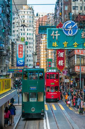 tramline: HONG KONG - March, 14, 2009: Double-decker tram in Hong Kong street