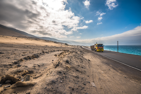 desert highway: Panamericana road with Pacific ocean on the right