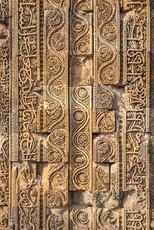 mughal: Carved walls of Qutub Minar complex, Delhi, India