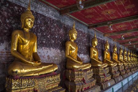 Golden buddhas in Wat Suthat, Bangkok, Thailand