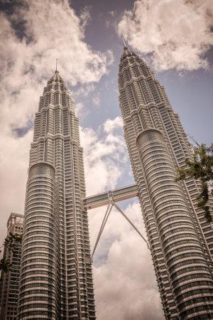 tallest bridge: Retro style image of Twin Towers in Kuala Lumpur, Malaysia Editorial