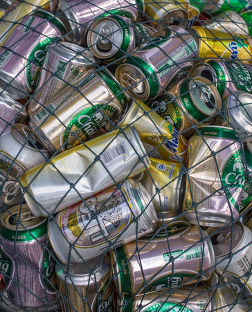 crushed cans: Koh Kud, Thailand - February 02, 2016: Used beverage cans gathered in a pile