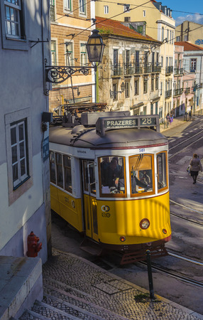 28: LISBON, PORTUGAL  March, 28, 2014: Famous yellow tram 28, one of the main tourist attractions in Lisbon