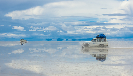 Off-road vehicles driving in Salar de Uyuni, Bolivia, the worlds largest salt flat