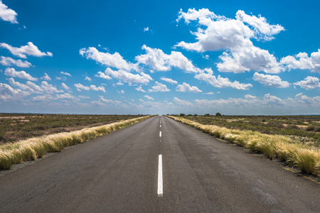 vibrant image of highway and blue cloudy sky Stock Photo