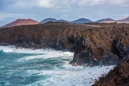 Volcanic coastline near Los Hervideros lava caves in Lanzarote, Canary islands, Spain