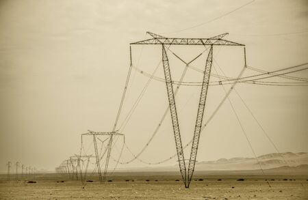 High voltage lines and power pylons Imagens