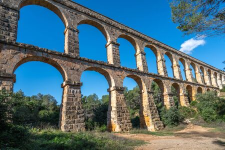 Ancient roman aqueduct Ponte del Diable or Devils Bridge in Tarragona, Spain.