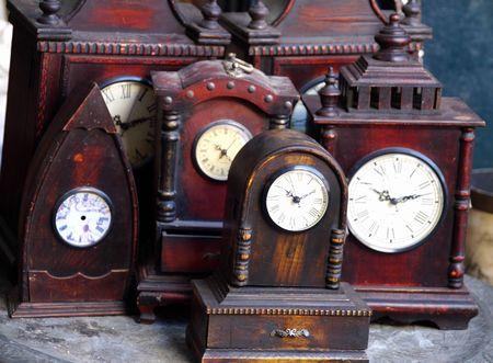 Old clocks in antiques shop
