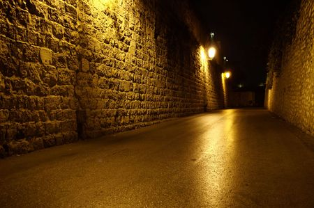 a street in jerusalem old city at night photo