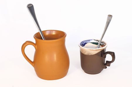 capacino: Coffee cup with a spoon, isolated