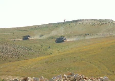 middle east war: israeli tanks attack - battle field, milotary exercise Stock Photo