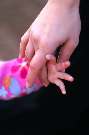 seniority: Child Girl and mother hands - help and support