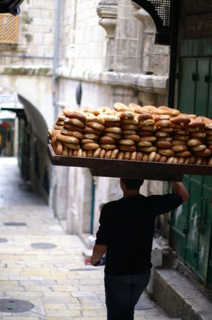 arabian food: Arab, seller of east bread on Old Jerusalem street Stock Photo