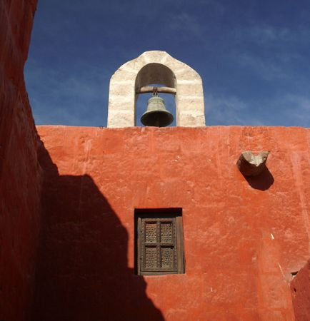 quechua: A bell in Red and White colors of old monastery Santa Catalina in Arekipa, Peru