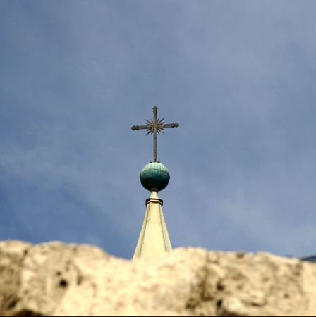City of Arekipa in Peru - tourists attraction - cross on a blue sky photo