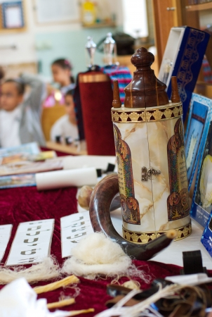 Torah scrolls in sinagogue on jewish holiday photo
