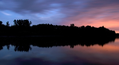 Romantic blue black red sunset over a lake photo