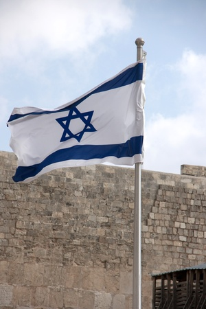 bank western: flag of state of israel over western wall in jerusalem