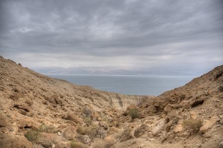 dea: Stone desert in Israel Dead Sea travel under dramatic sky