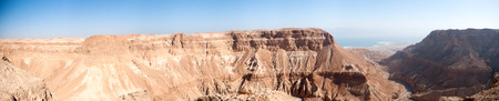 Wide panorama of stone desert mountains in Israel near Dead Sea photo