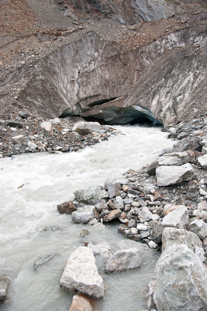 kavkaz: River stream from a glacier in mountain hiking attraction