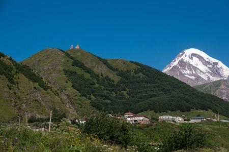 kavkaz: Kazbek mountain and Trinity church in Georgia adventure travel