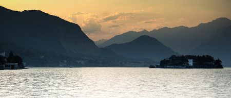 Romantic sunset on a lake in North Italy during summer vacation Stock Photo
