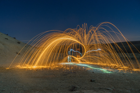 mideast: Desert mountain and light painting at night