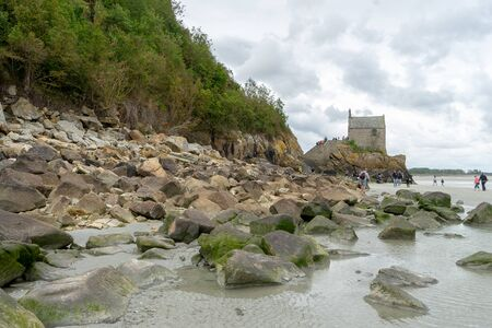 Normandy abbey attraction for vacation tourism in cloudy weather
