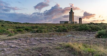 Romantic sunset in France sea coast travel attraction lighthouse 스톡 콘텐츠