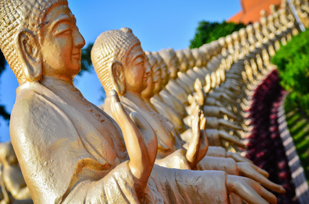 the series: A series of Buddha statues standing in a row Stock Photo