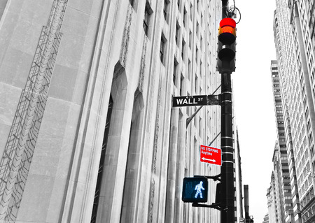 red wall: Wall Street road sign and traffic lights.
