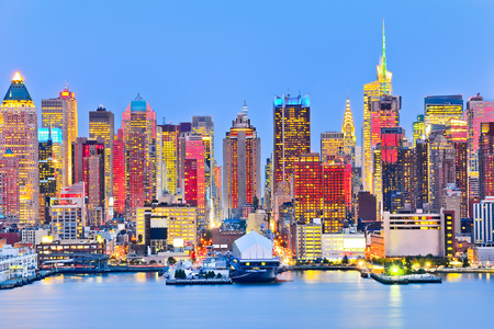 Manhattan skyline with red sunlight reflection.