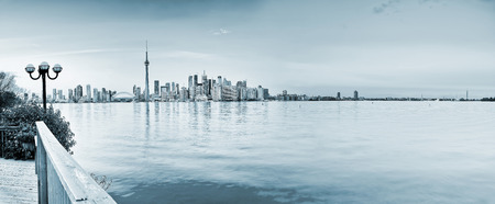 Panorama of Toronto City reflected on the lake.