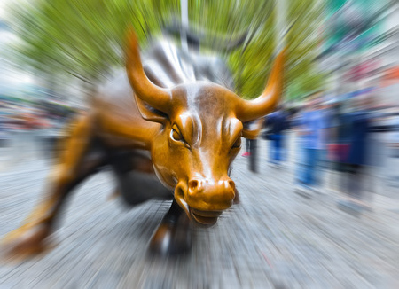 NEW YORK CITY, NY - OCT 11: Charging Bull sculpture on October 11, 2013 in New York City The sculpture is both a popular tourist destination and a symbol of the New York Stock Exchange.. Editorial