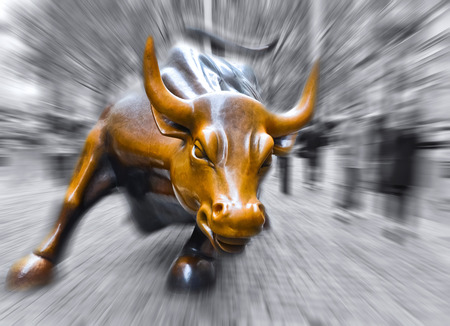 NEW YORK CITY, NY - OCT 11: Charging Bull sculpture on October 11, 2013 in New York City The sculpture is both a popular tourist destination and a symbol of the New York Stock Exchange.. 報道画像