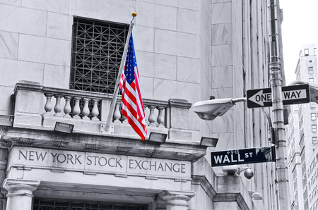 nasdaq: . NEW YORK CITY, NY - OCT 11: The side entrance of New York Stock Exchange and a street sign of Wall Street shown on October 11, 2013 in New York City The Exchange building was built in 1903. Editorial